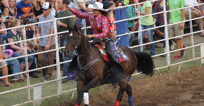 Rodeo Queen Lexus King greets the crowd at the Manawa Rodeo.