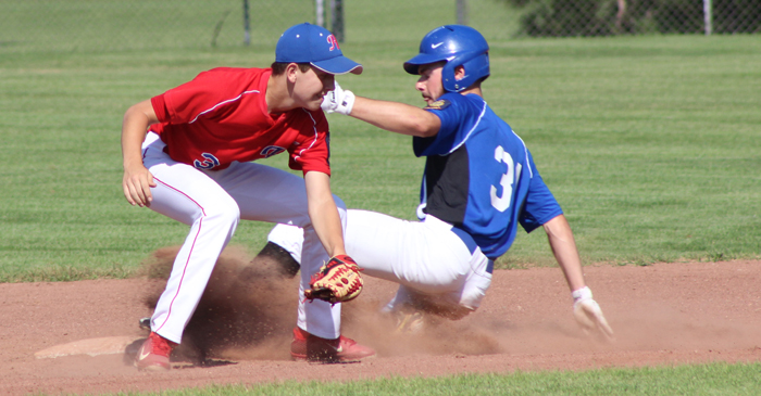 Waupaca's Shane Olsen steals second base as Hortonville's Aaron Bonikowske waits for the ball. Hortonville won the game 9-6 to eliminate Waupaca from the Class A Legion baseball tournament.