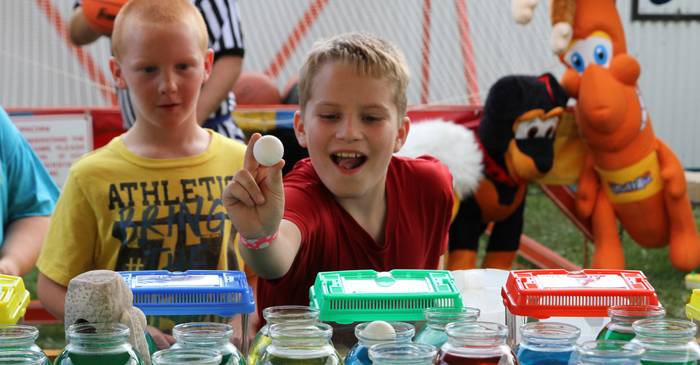 Soren Grenlie, 10, tries his hand at winning a gold fish.