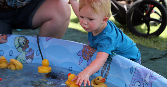 Brooke Jacowski, 2, looks for the perfect duck to pick.