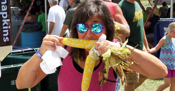 Amy Powers takes a big bite of her first ear of corn.