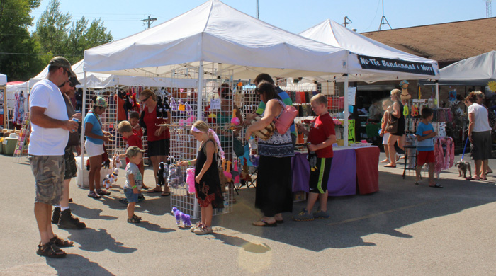 Families check out some of the vendors at Fremont's Yellowstone Trail Festival. Last weekend's event also include music, a night glow run and helicopter rides.