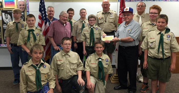 The Knights were represented by Darrell Cornell and Giles Belling presenting the check. Other troop leaders (from left in back) are: Vance Linden, Troop Committee Chairman; Rob Karski, Scoutmaster; and Steve Frings, Assistant Scoutmaster.