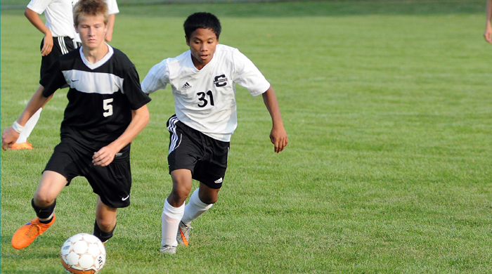 Clintonville soccer player Joshua Schroeder, right, hustles for the ball at the Truckers' home game Thursday, Aug. 27.