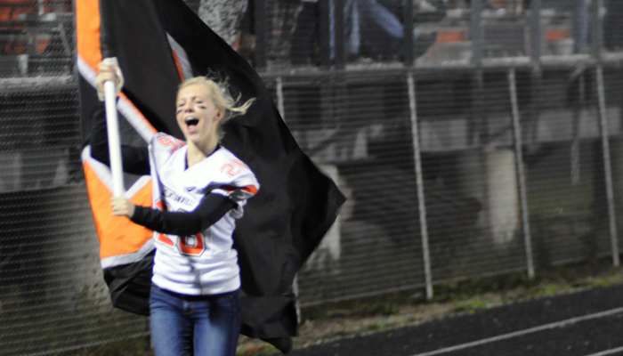 Clintonville senior Emily Klein dashes down the track celebrating the Truckers' third touchdown on Friday, Sept. 25.  Scott Bellile Photo