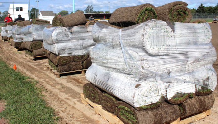 Pallets of sod from Neuroscience Group Field at Fox Cities Stadium are ready to be installed on Weyauwega-Fremont High School's baseball diamond.  Greg Seubert Photo