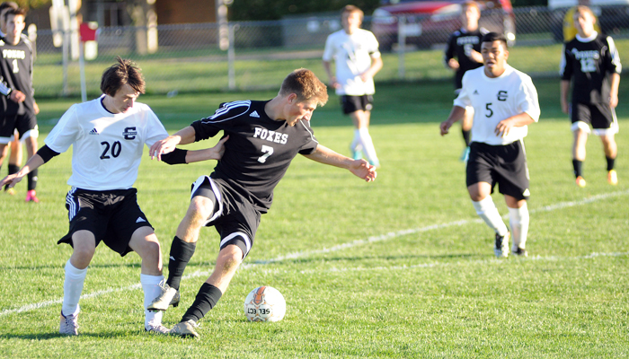 Clintonville's Ryan Krieser, 20, fights a Fox Valley Lutheran player for the ball on Thursday, Oct. 1.  Scott Bellile photo