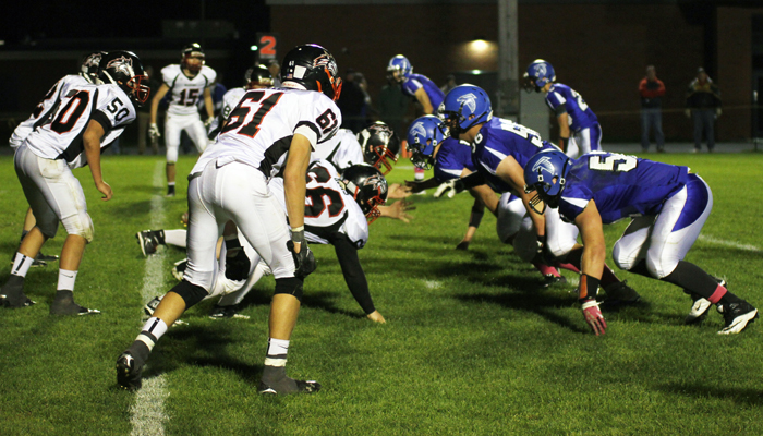 Manawa's offense and Amhersts defense face off. Holly Neumann photo.