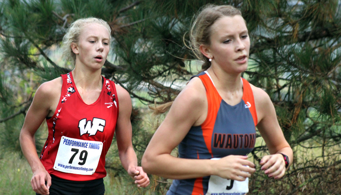 Weyauwega-Fremont's Daisy Wilson (left) keeps pace with Wautoma's Ashley Caswell in the girls' race.  Greg Seubert Photo
