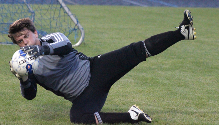 Waupaca goalkeeper Logan Borland warms up Oct. 8 before the Comets' North Eastern Conference matchup with Clintonville at Waupaca High School. The Truckers handed the Comets a 2-1 loss. Waupaca will open WIAA state tournament play Tuesday, Oct. 20. Greg Seubert Photo
