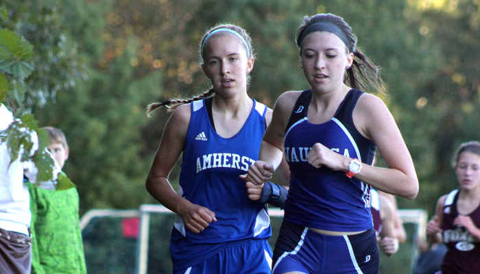 Waupaca's Ashley Jeske (right) keeps pace with Amherst's Anja Werner during the girls' race. Jeske placed 29th, while Werner was 28th.  Greg Seubert Photo