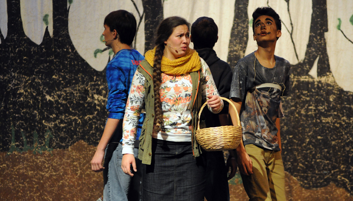 """Hortonville High School students (center, moving clockwise) Breylin Soto (Dorothy), Tony Fannin (Tin Man), Brad Hansel (Cowardly Lion) and Jeremy DeLain (Scarecrow) explore a creepy forest on their way to the Emerald City while rehearsing """"The Wizard of Oz"""" on Thursday, Oct. 29.  Scott Bellile photo"""