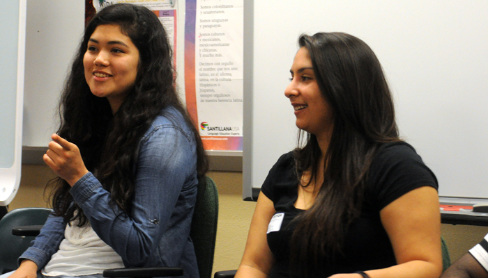 Former New London High School student and current UW-Oshkosh freshman Ruby Fortuno engages in a discussion about college life with UW-Oshkosh freshman Cassandra Moreno. Scott Bellile photo
