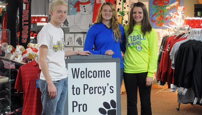 Percy's Pro Shop student workers (L to R) Robbie Watling, Leah Porath and Abby Elsholtz are among 25 students who keep the seasonal store running at Familiar Grounds.   Scott Bellile photo