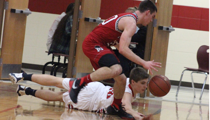 Manawa's Ethan Hass and Weyauwega-Fremont's Jacob Young try to keep a loose ball from going out of bounds Dec. 18 during a Central Wisconsin-8 Conference boys' basketball matchup in Weyauwega. W-F won the game 80-50 behind 25 points from Logan Bosquez and Dylan Pankow.  Greg Seubert Photo