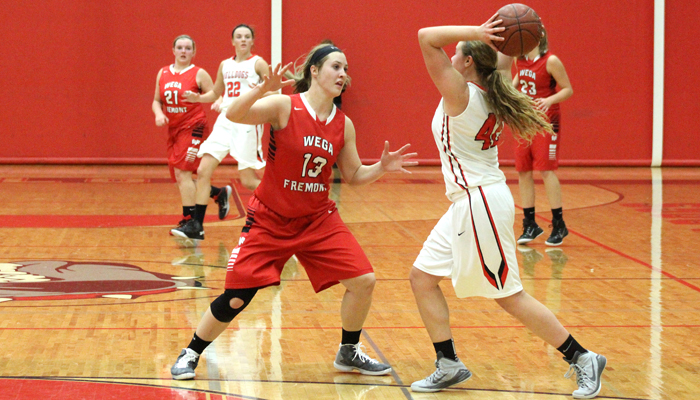 Weyauwega-Fremont's Karissa Akey defends New London's Leah Porath in the second half of a nonconference matchup in New London.  Greg Seubert Photo