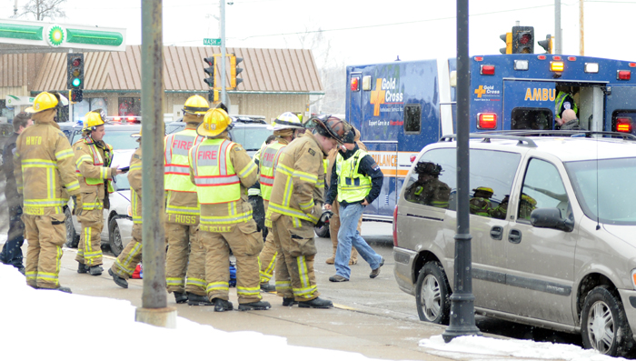 Hortonville firefighters, police and EMS work at the scene of a multi-vehicle accident in downtown Hortonville on Friday, Jan. 22. Scott Bellile photo