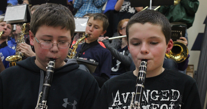 Waupaca Middle School eighth-graders Dominic Silva and Nick Abrahamson perform with the Waupaca High School pep band Jan. 21 during a girls' basketball game at the high school. The combined bands included more than 180 musicians.  Greg Seubert Photo
