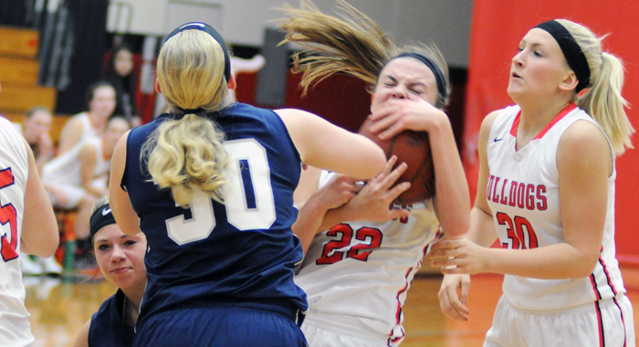 New London's Kali Rohan is fouled by Menasha's Ashley Siegel during a conference victory over the Blue jays last Friday.  (At right) Bulldog Sophomore Josie Hintzke.  John Faucher photo