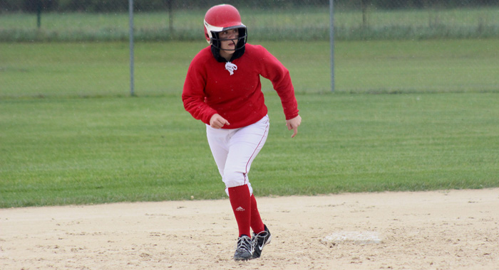 Weyauwega-Fremont courtesy runner Tatum Williams takes off for third base in the second inning of the Indians' win over West De Pere.  Greg Seubert Photo