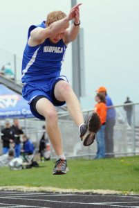 Jared Doro competes in the triple jump event for Waupaca in Clintonville. He placed ninth.  Scott Bellile Photo