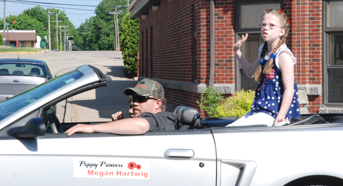 Poppy Princess Megan Hartwig waves to parade attendees.   Bert Lehman photo