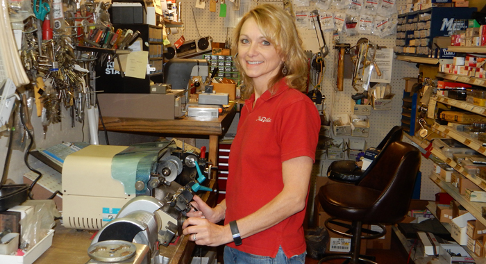 Bonnie Olsen with the equipment she uses for making keys at JR's. Robert Cloud Photo