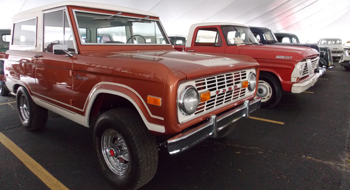 Trucks in the feature tent included a 1973 Ford Bronco (front), exhibited by Curt Hendrickson, of Green Bay, and an unrestored 1967 Ford F-100 Stepside, manufactured in Ontario, Canada, and exhibited by RichardCleer, of Ipava, Illinois.Jane Myhra Photo