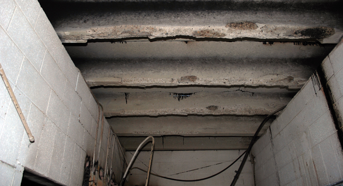 The city of Clintonville is still in the process of working with its insurance company to get cost estimates to repair the roof of the fire-damaged building at the city swimming pool. Wisconsin Department of Justice photo