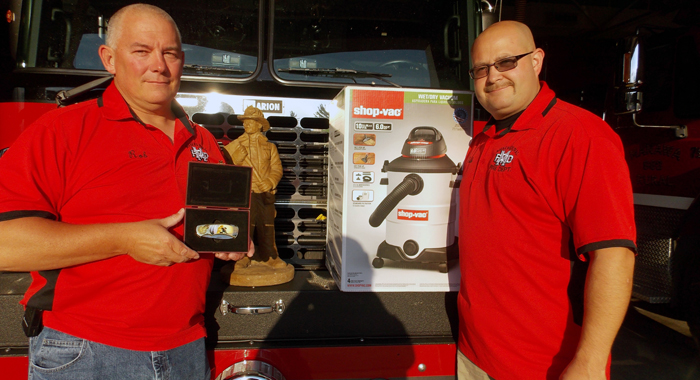 Fire Chief Rob Rosenau (left) and Assistant Chief Josh Smith show the gifts the Manawa Rural Fire Department received from John Chaplin. Jane Myhra Photo