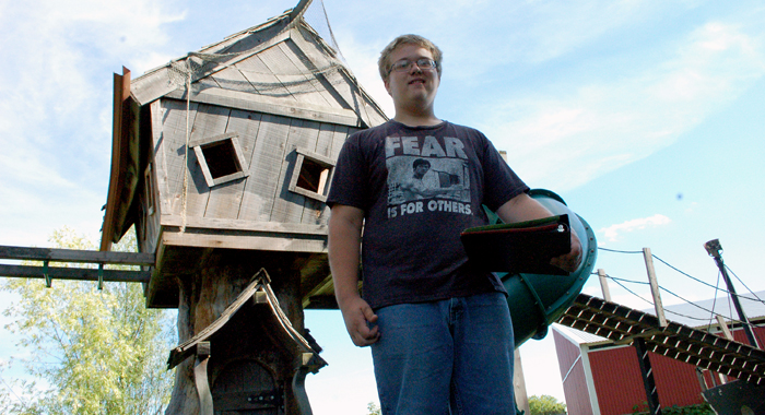 Storm Handrich stand by his tree house that he will donate to Mosquito Hill Nature Center.  John Faucher photo