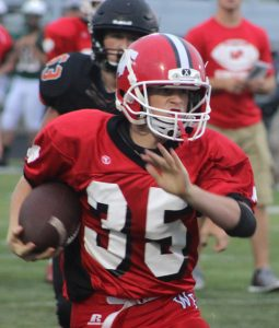 Zarek Hoffman carries the ball for Weyauwega-Fremont as the Indians' offense matched up against Clintonville's defense at a scrimmage in Ripon. Greg Seubert Photo