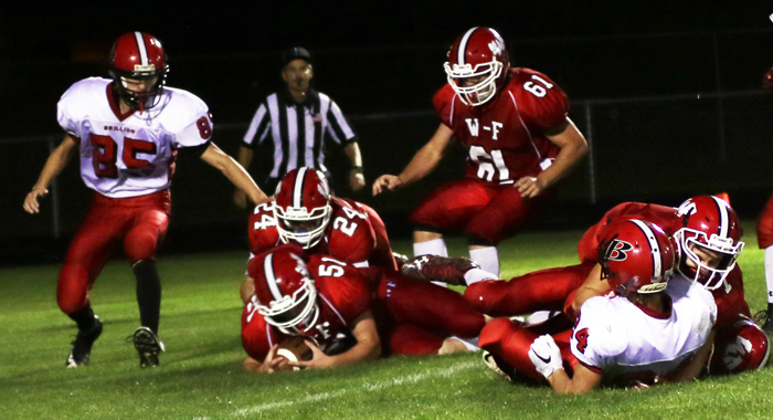 Weyauwega-Fremont's Alex Bartel recovers a fumble.  Holly Neumann Photo