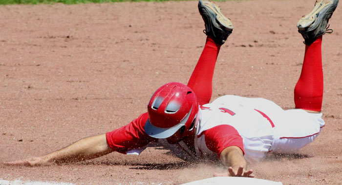 David Yeska slides headfirst into third base for the Waupaca Lakemen during a recent BABA South-Central Division game against Scandinavia. Both teams are in the BABA playoffs, as Waupaca will host Lanark and Scandinavia will travel to Plover. The games are scheduled for 1:30 p.m. Sunday, Aug. 14. Greg Seubert Photo