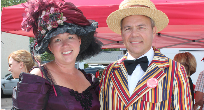 JoLene Nollenberg, chairperson of this year's Horse & Buggy Days, and Tim Dietzen, president of the Weyauwega Chamber of Commerce, model the attire they borrowed for the Sept. 17 Horse & Buggy Days Parade. Her dress and his suit were compliments of Wega Arts.