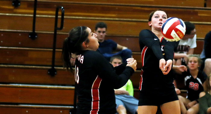 Manawa's Ellen Field gets under the ball to break a Weyauwega-Fremont serve. Holly Neumann Photo