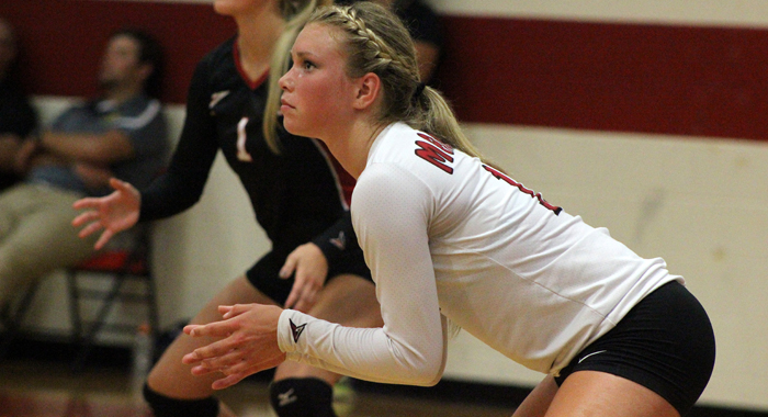 Manawa libero Haley Reierson waits for a Weyauwega-Fremont serve. Greg Seubert Photo