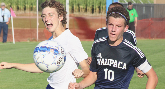 Waupaca's Seth Boldt (right) and a Wrightstown player keep an eye on the ball. Greg Seubert Photo
