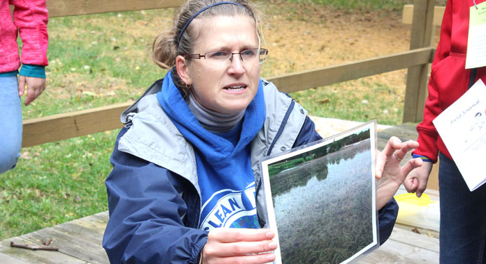 Amy Thorstenson, regional aquatic invasive species coordinator, shows fifth-graders what happens if a lake gets infested with Eurasian water-milfoil, one of several aquatic invasive species found in Wisconsin. Greg Seubert Photo