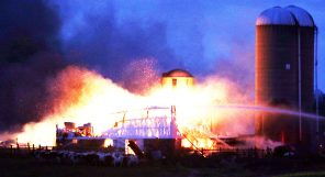 Flames ripped through a barn located on Symco Road, just outside of Manawa on Friday, Nov. 18.  Holly Neumann Photo