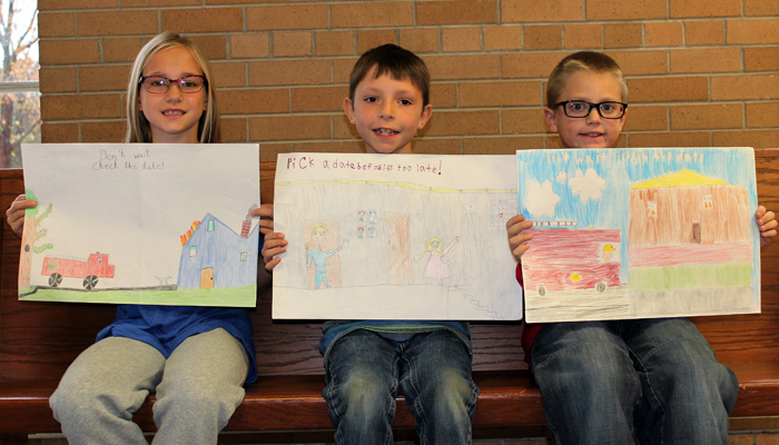 The third-grade winners of this year's poster contest are (from left) Lake Curtis, Evan Graham and Carter Rupno. Missing in the photo is Miya Davis.