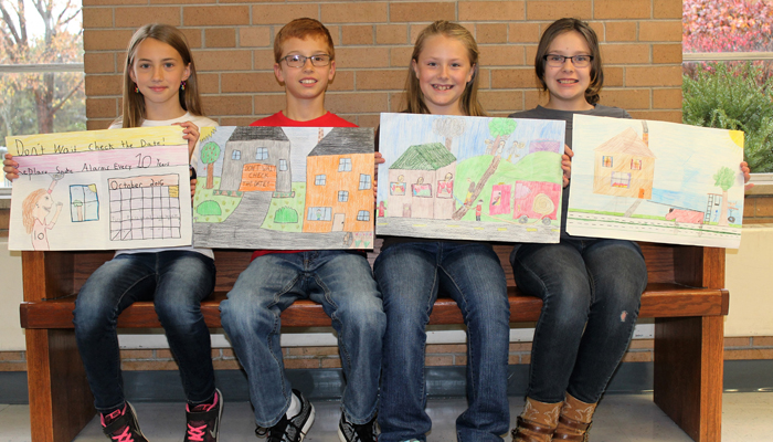 The fifth-grade winners of the poster contest are (from left) Lauren Feltz, Reed Curtis, Hailey Wohlt and Jessica Miller. Angie Landsverk Photos
