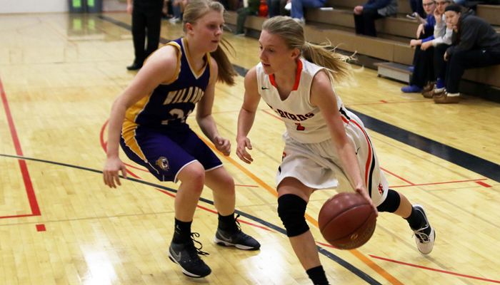 T-Bird Erika Kisting drives the ball to the hoop under the pressure of Anna Caswell. Holly Neumann photo.