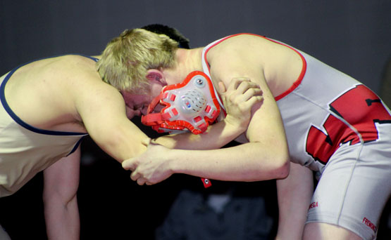 Weyauwega-Fremont wrestler Kyle Loehrke loses his head gear while going up against Markesan's John Bartaszewicz in a 170-pound match Jan. 6 in Weyauwega. Loehke lost the match 2-0, but the Indians picked up a nonconference win. Greg Seubert Photo