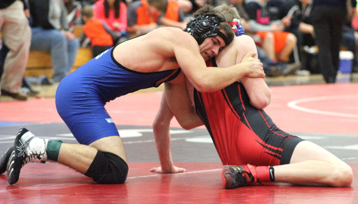 Waupaca's Mitchell Pecher faces Sturgeon Bay's Nathan Hendrickson in a 160-pound match during the first round of the Cutler Classic in New London. Hendrickson pinned Pecher and Pecher went on to post a 1-2 record at the 15-team tournament.
