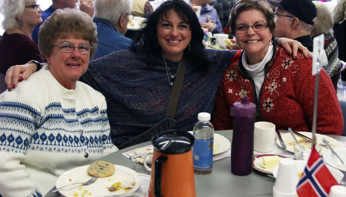 Guests at the Iola Winter Carnival's Norwegian Lutefisk Supper included (from left) Sherry Neidert, Tami Spennetta and Ellen Eckhardt.