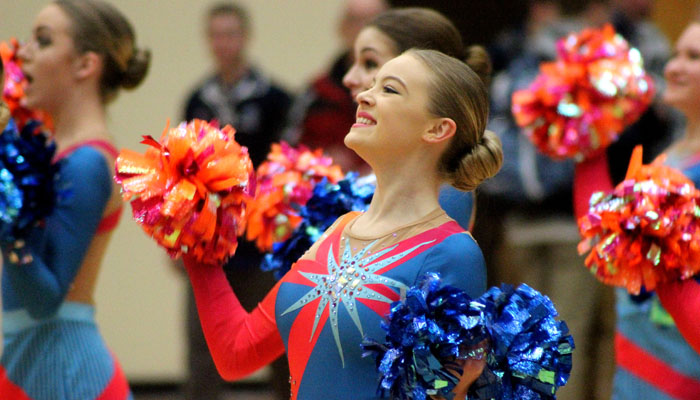 Elianna Stanchik performs a Pom routine with Waupaca High School's dance team Feb. 2 following a boys' basketball game at the school. The team's in Division 2 Pom routine placed second behind New Berlin Eisenhower Feb. 4 at the state cheer and pom competition in La Crosse. Greg Seubert Photo