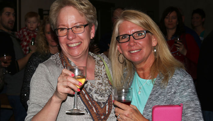 Ronda Mollica (left) and Karen Riemer enjoyed a drink together at Taste of Wisconsin. Holly Neumann Photo