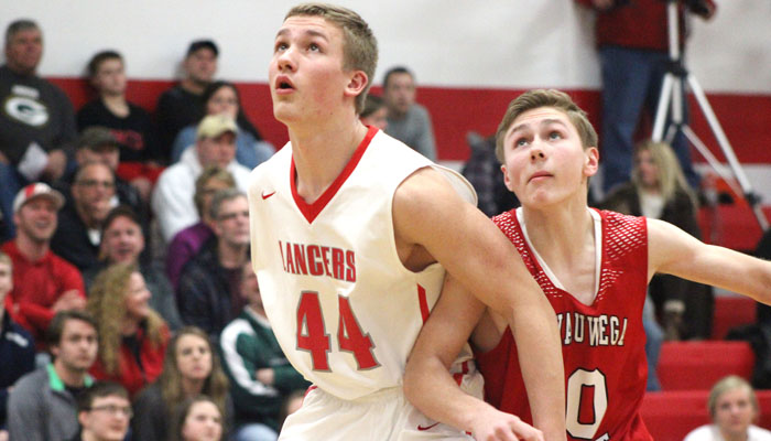 Manitowoc Lutheran's Ben Thorn keeps Weyauwega-Fremont's Levi Erdmann from getting a rebound after a missed free throw in the second half.Greg Seubert Photo