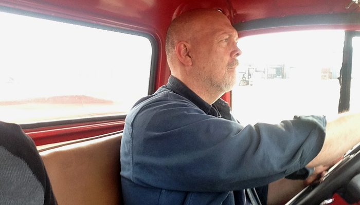 After providing a tour for the Clintonville Tribune-Gazette of the new FWD Museum, Jim Hogan goes for a drive around Clintonville in a 1965 pumper tanker firetruck built by FWD. Erik Buchinger photo